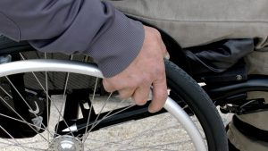 Wheelchair With Hand On Wheel | Book FHR Travel Blog