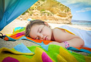 Girl Asleep On Beach | Book FHR Travel Blog